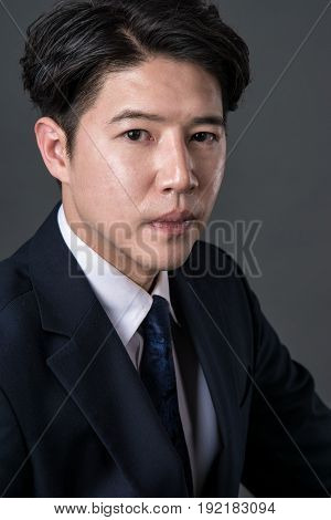 East Asian businessman shooting studio portrait photo