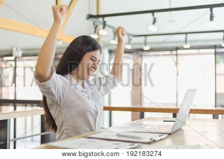 Business people with arms up and smile business success