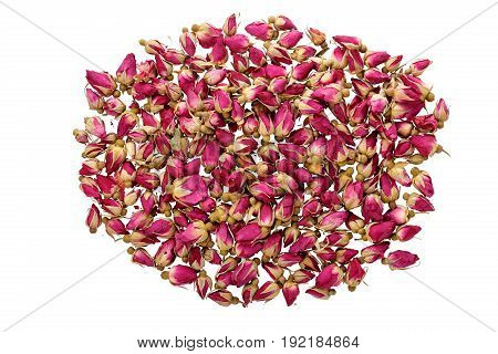 Close-up of dry red rose buds. Healthy herbal tea Isolated on white background Top view
