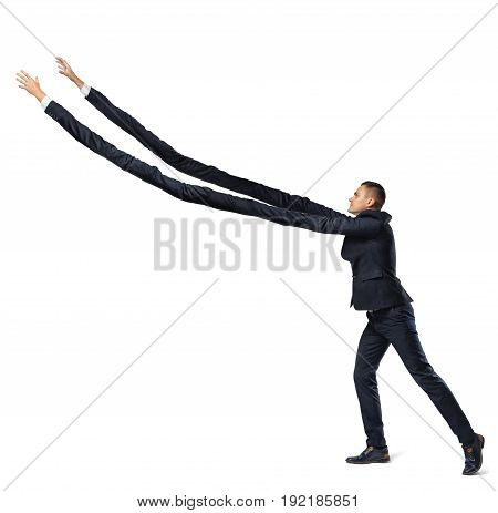 A businessman on white background in side view with extremely long arms trying to grab something above. Business and success. Hard work and effort. Greed.