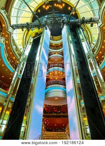 Venice, Italy - June 06, 2015: Cruise ship Splendour of the Seas by Royal Caribbean International at port Venice, Italy on June 06, 2015. The details of interior of cruise ship. The interior near the elevator inside the ship