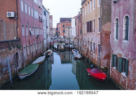 landscape with the image of boats on a channel at in Venice, Italy