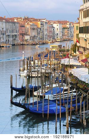 Landscape with the image of boats on a channel at sunrise in Venice, Italy