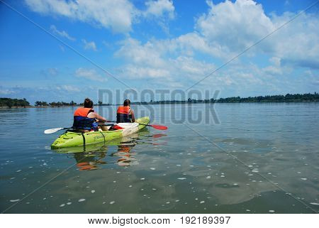 11TH MAY 2014, DON DET, LAOS - Tourists on a kayaking tour on the Mekong River looking for pink dolphins near Don Det 4000 Islands Laos