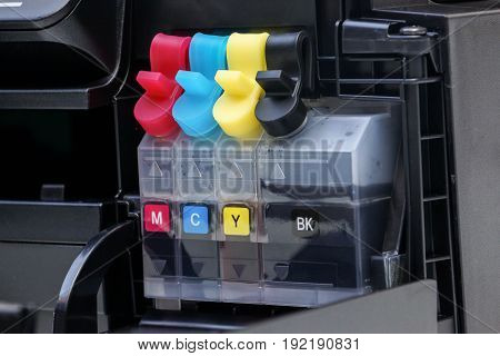 Refill ink tank with four colors for a printer