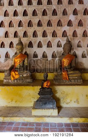 ancient sitting Buddha in Wat Sisaket temple, Vientiane Laos
