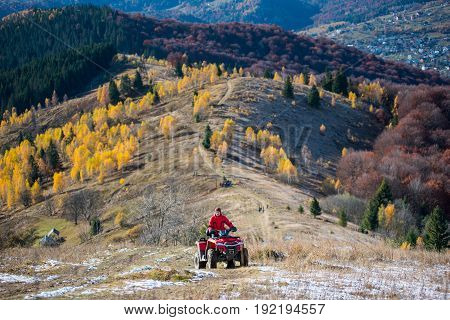 Off-road Vehicle With Guy On A Mountain Road Passes To The Top Of The Mountain Followed By A Beautif