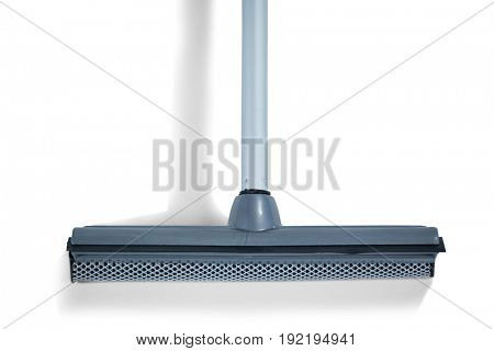 Close-up of squeegee mop on white background