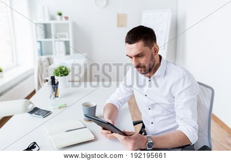 business, people and technology concept - businessman with tablet pc computer at office