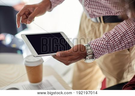 business, people and technology concept - businessman with tablet pc at office