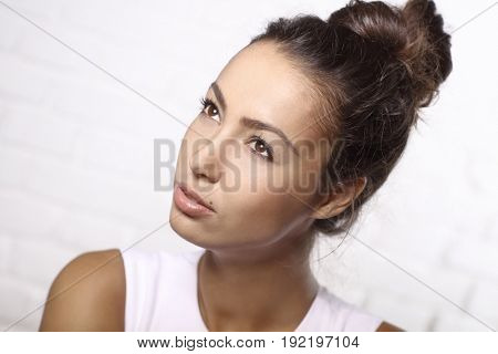 Closeup portrait of attractive young woman looking away.