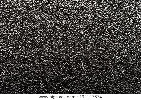 a background of rough black sand paper