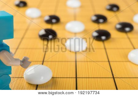 robot playing GO concept of AI horizontal composition
