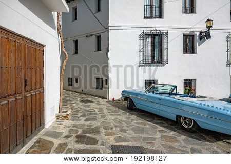 Wide angle view of traditional vintage town, houses and car