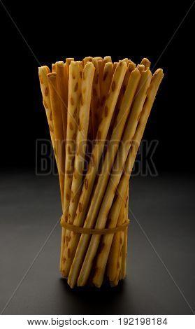 side view pretzel sticks on a black background