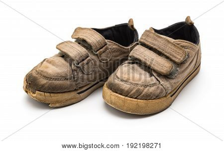 pair of old grey shoes on a white background