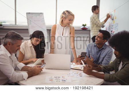 Smiling business people planning in creative office