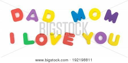 DAD MOM I LOVE YOU shaped by alphabet jigsaw puzzle on white as concept of family