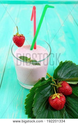 Strawberry-milkshake in a glass on a bright background Dietary menu. Proper nutrition.