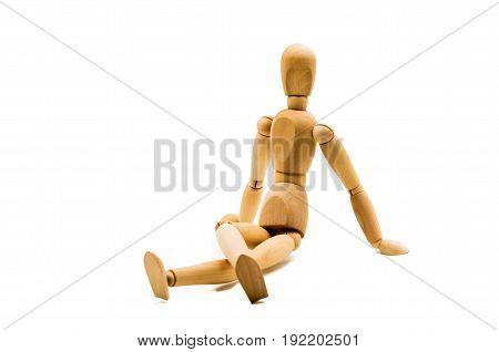 wooden man puppet sitting on white background