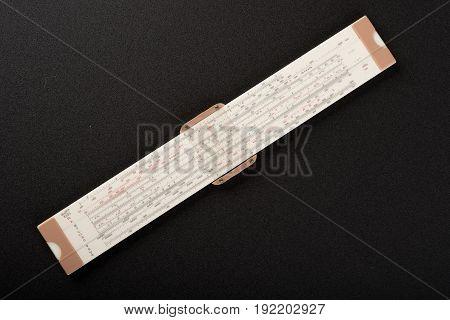 professional vanitation pipe ruler on top of black sand paper