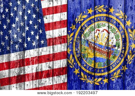Flag of US and New Hampshire painted on wooden frame