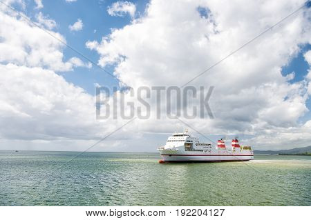 cargo ship. Modern cargo ship at sea in sunny day with blue sky and cloud. transportation concept. International Container Cargo ship in the ocean Freight Transportation Shipping Nautical Vessel
