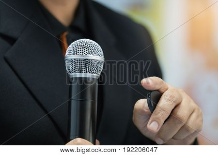 blurred of businesswoman speech talking with microphone keynote and remote to presentation