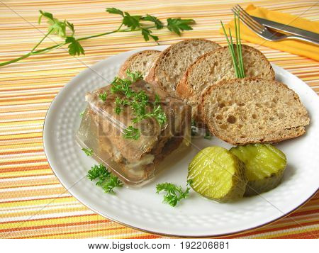 Fried herring in aspic witth bread and pickled gherkin