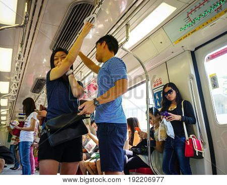 People On The Subway Train In Singapore