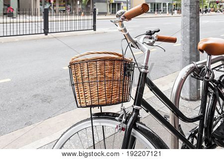 Vintage style bicycle with basket parked on the street in Adelaide CBD area South Australia