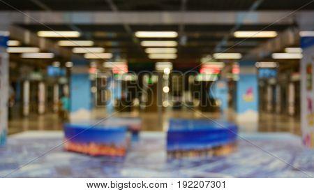 Underground subway station blur background with bokeh light