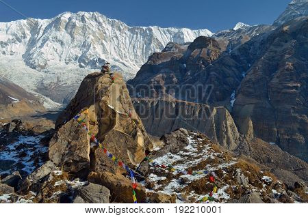 Stone grave of a climber in Annapurna Base Camp, Nepal.