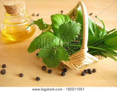 Basket with herbs, chives, lemon balm, basil