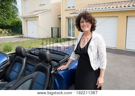 Smiling Cheerful Brunette With Car At Home Suburb