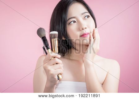 Long Hair Asian Young Beautiful Woman Applying Cosmetic Powder Brush On Smooth Face Isolated Over Pi