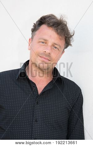 a outdoors portrait forties handsome man outdoors