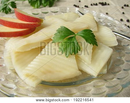 Homemade celery salad with herbs, spices and apples