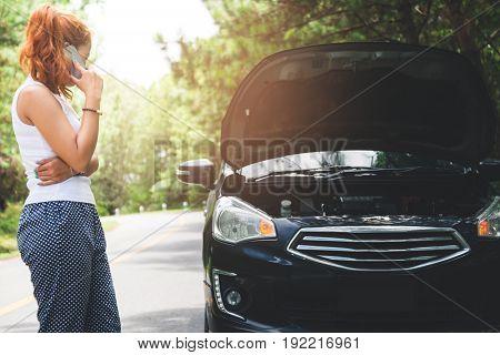 Women The car was broken on the highway. countryside. Women broken car