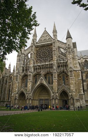 facade of westminster abbey in london during autumn