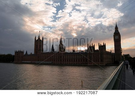 sunset over river thames in london in england