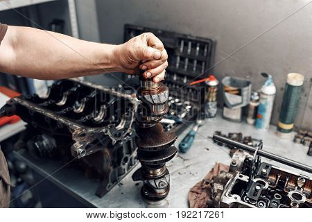 mechanic repairman at automobile car engine maintenance repair work