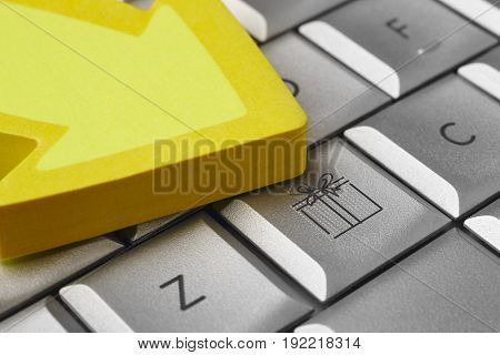 Gift symbol on a computer key. E-commerce market. Shopping. Horizontal