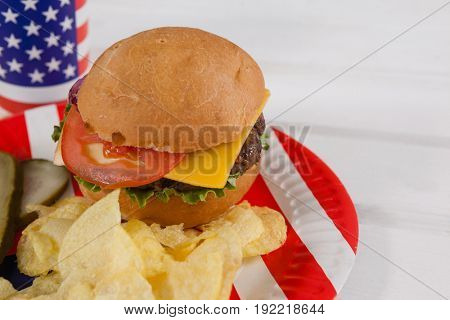 Close-up of snacks in plate decorated with 4th july theme