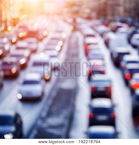 Defocused photo of roads with cars riding in summer