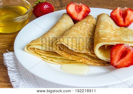 Crepes Stack With Strawberry And Honey Syrup