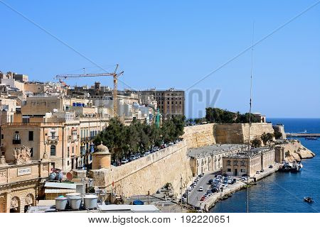 VALLETTA, MALTA - MARCH 30, 2017 - Victoria Gate and city buildings on the East side of the grand harbour Valletta Malta Europe, March 30, 2017.