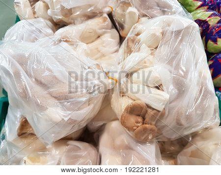 Raw Organic King Oyster Mushrooms or Pleurotus eryngii in plastic bag sold in supermarket Thailand