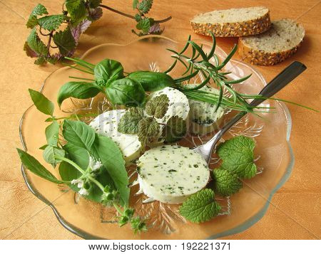 Herbs butter with basil, lemon balm, rosemary, chives