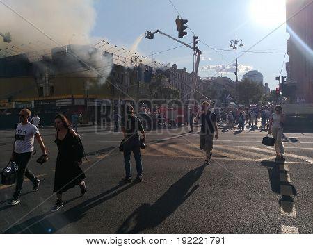 KIEV - UKRAINE - JUNE 2017:  Fire in historic building at Kreschatik Street at city center. Fireman, poliece, Firefighters extinguish a fire near famous TZUM department store. 20-th of June